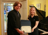 W.F. Lantry receiving his Honorable Mention from String Poet Founder and Editor Annabelle Moseley