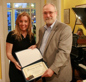 George H. Northrup receives his Runner-up award from String Poet Founder and Editor Annabelle Moseley