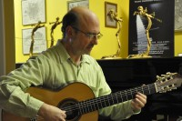 Harris Becker performs classical guitar at the String Poet Studio Series